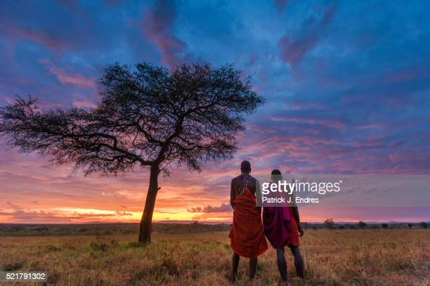 Two Masai tribesmen and acacia tree