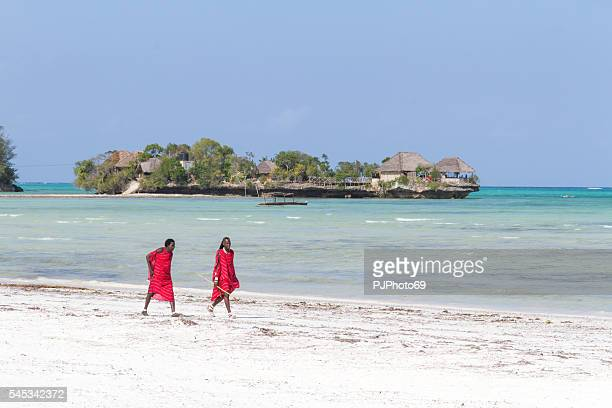 two masai warriors walking on the beach - pjphoto69 stock pictures, royalty-free photos & images