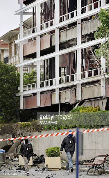 Two masked Basque police officers walk on May 19 2008 in front of the destroyed Maritime Club in the northern Spanish Basque town of Getxo No victims...