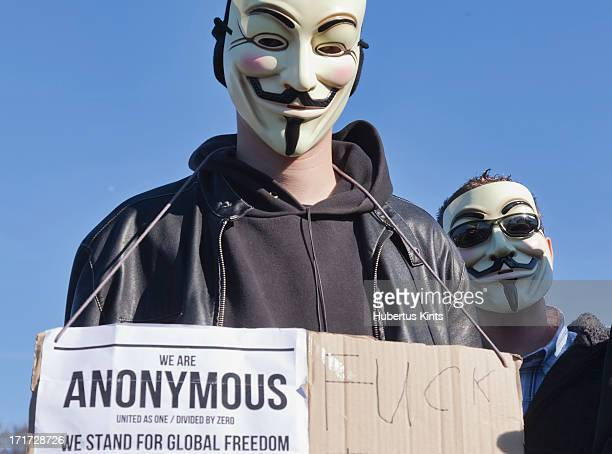 CONTENT] Two masked members of Anonymous protesting during the Occupy protest on October 15 2011 in The Hague The Netherlands