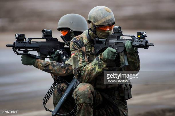 Two masked soldiers from the detail of electronic warfare with ready to fire guns. Shot during an exercise of the land forces on October 13, 2017 in...