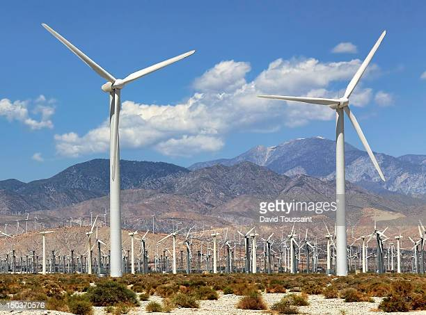 two massive wind turbines - palm springs stock-fotos und bilder
