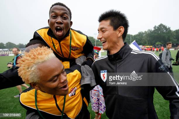 Two Matabeleland players jump on the shoulders of Yong Hak An of the United Koreans team during the opening ceremony of the Conifa World Football Cup...