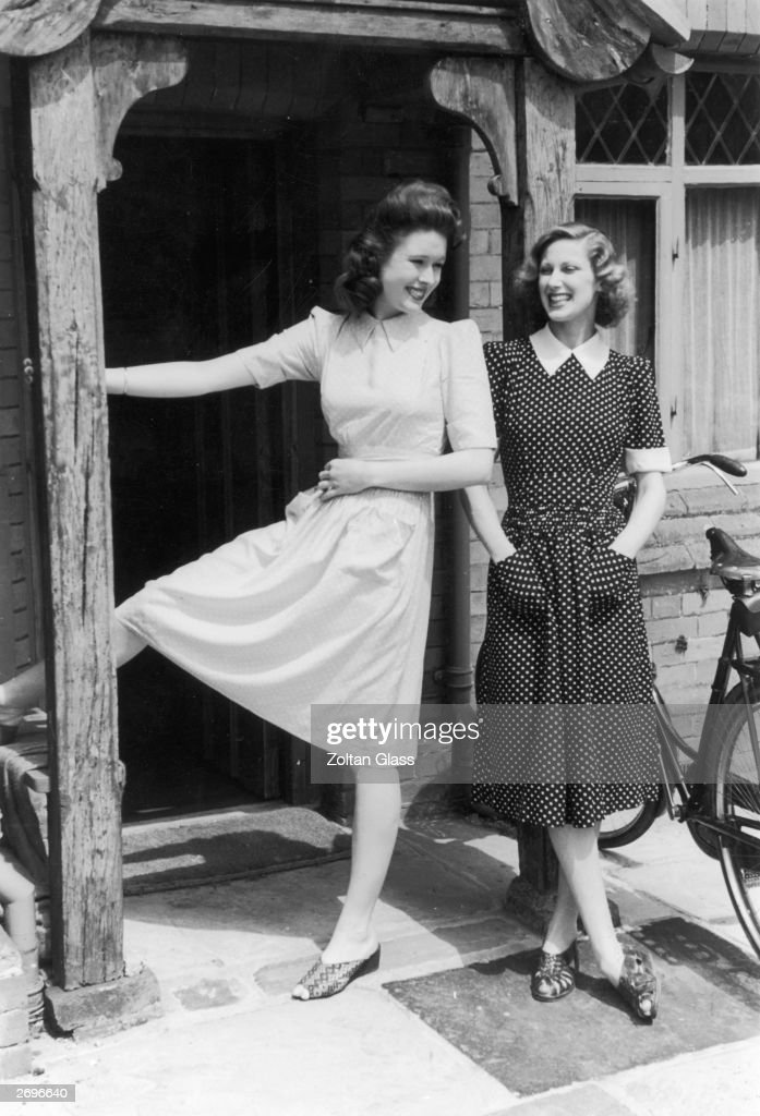 Two matching summer dresses in spotted materials. They have fitted waists and patch pockets and short sleeves with cuffs just above the elbow. They each need seven clothing coupons. Original Publication: Picture Post - 794 - Clothes for a Coupon Summer - pub. 1941