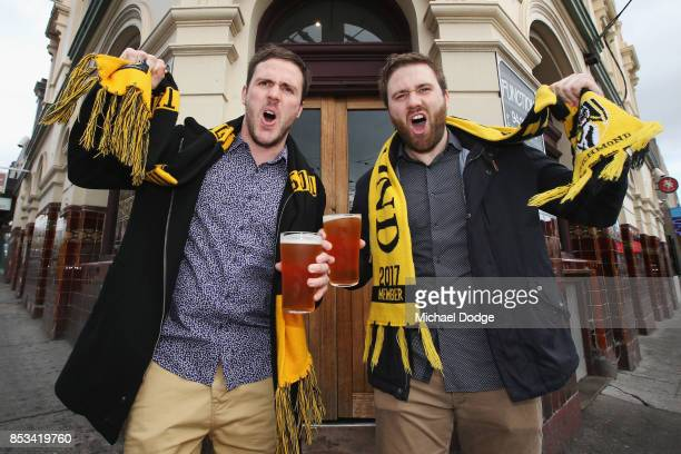 Two mates and Richmond Tigers fans show their support while having a beer at the Swans Hotel on September 25 2017 in Melbourne Australia The Richmond...