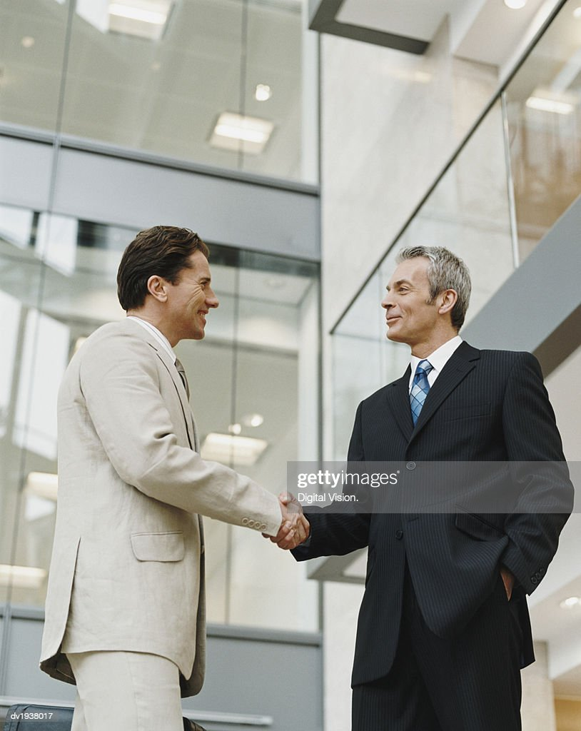 Two Mature Businessmen Shake Hands : Stock Photo