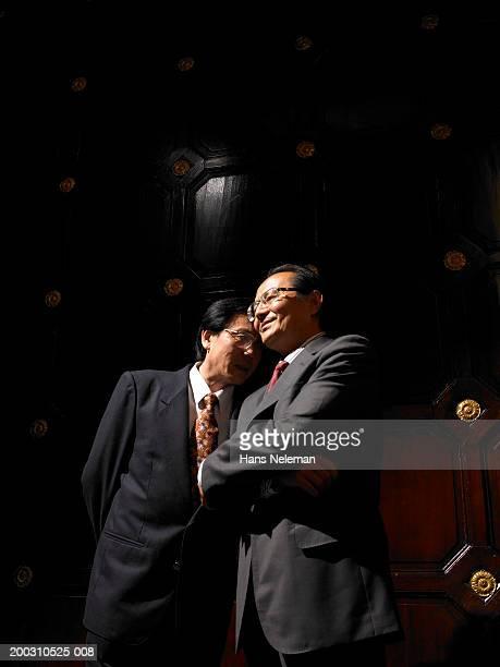 Two mature businessmen talking