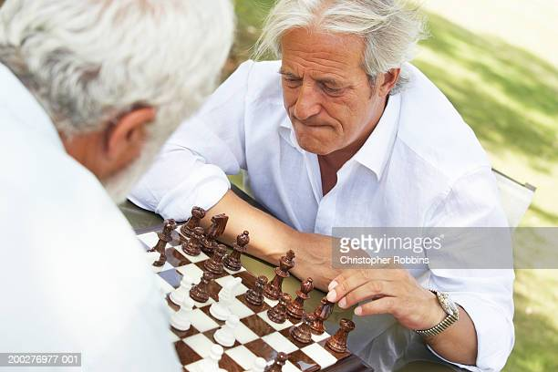 Two mature men playing chess, elevated view