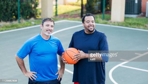 two mature men standing on basketball court - only mature men stock pictures, royalty-free photos & images