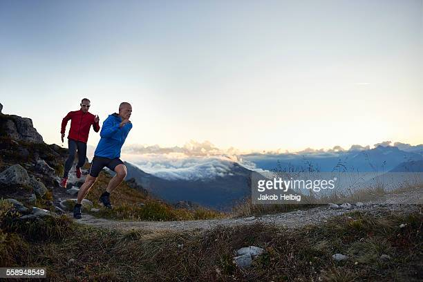 Two mature men trail running, Valais, Switzerland