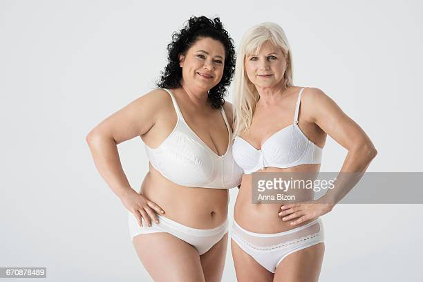 two mature woman in underwear. debica, poland  - fat old lady stock photos and pictures