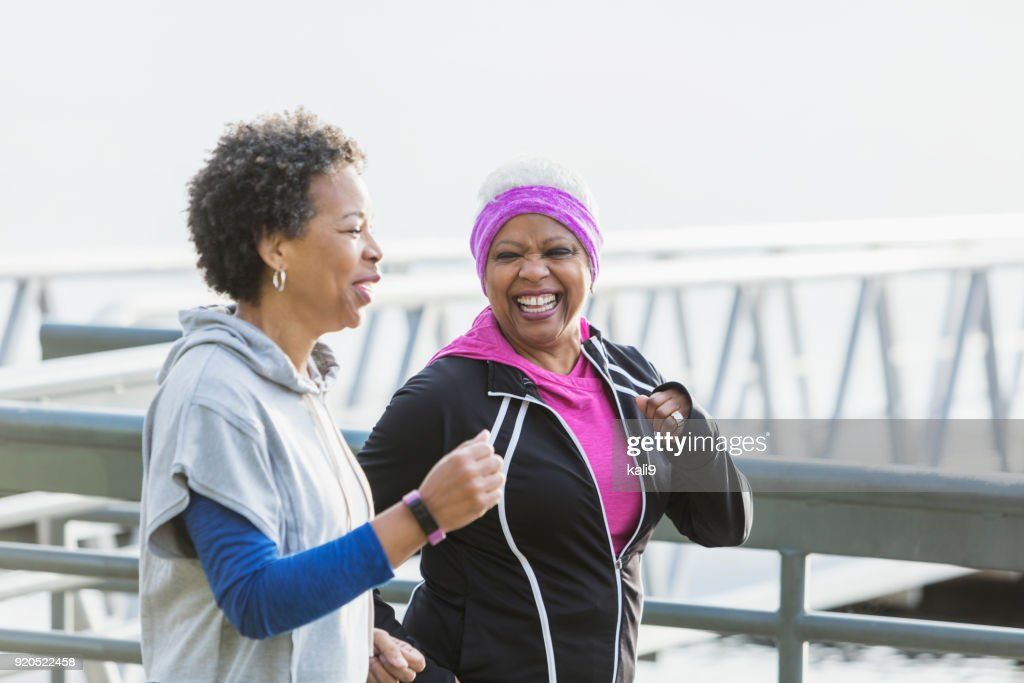 Two mature women jogging or power walking together : Stock Photo