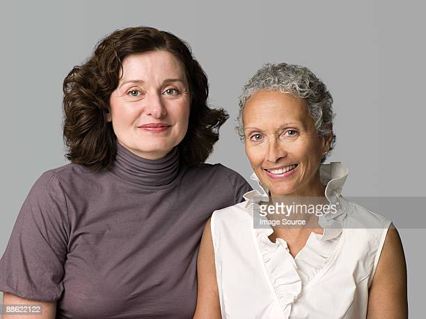 two mature women - female friendship stock pictures, royalty-free photos & images