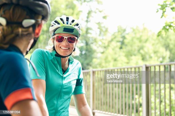 two mature women with cycling helmets - サングラス ストックフォトと画像