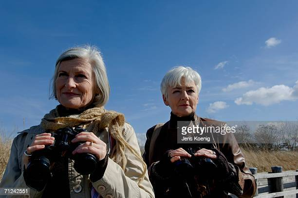 Two mature women with field glasses