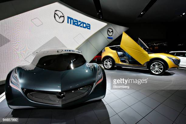 Two Mazda concept vehicles the Hakaze right and the Nagare sit on display during the New York International Auto Show Wednesday April 4 in New York