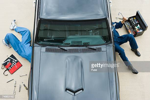 two mechanics repairing car - vintage auto repair stock pictures, royalty-free photos & images