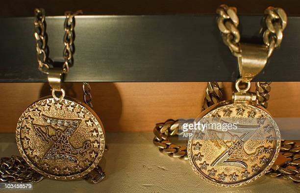 Two medals of the Zetas drug cartel are on display at the Museum of Drugs in Mexico City on August 18 2010 Goldincrusted weapons children clothes...