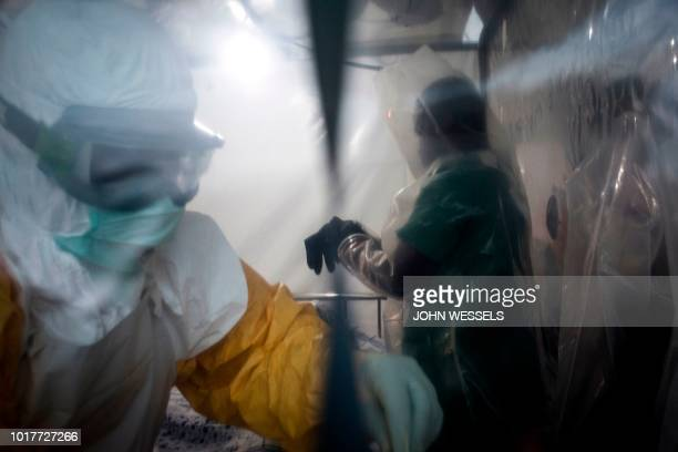 Two medical workers are seen in a Biosecure Emergency care Unite on August 15 2018 in Beni The new ETC will hold ten Biosecure Emergency care Unite...