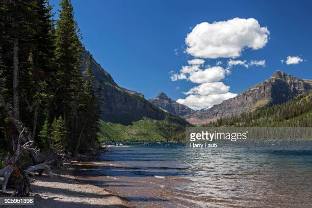 two medicine lake, cloudy sky, glacier national park, montana, usa - two medicine lake montana stock-fotos und bilder