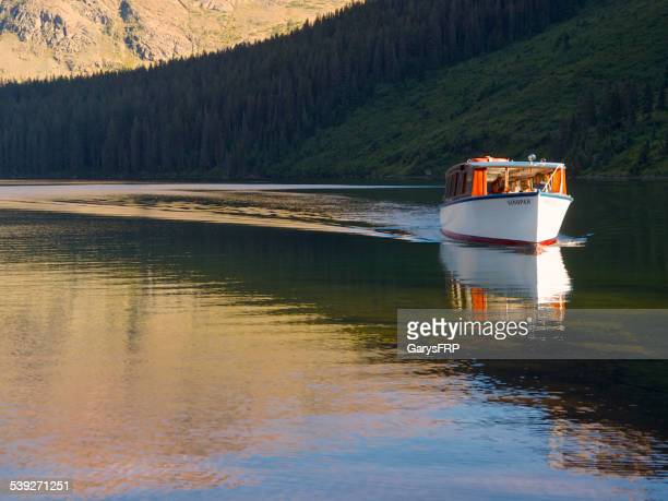 two medicine lake historic tour boat sinopah glacier national park - two medicine lake montana stock photos and pictures