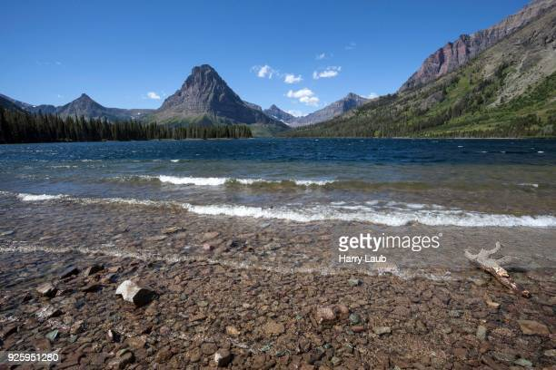 two medicine lake in front of sinopah mountain, glacier national park, montana, usa - two medicine lake montana stock-fotos und bilder