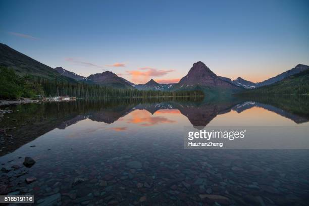 two medicine lake sunrise - two medicine lake montana stock photos and pictures