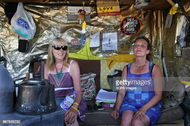 Two members of a local AntiFracking Group take shelter in a roadside hut to monitor Shale gas firm Cuadrilla's Fracking rig during a 48 hour Protest...