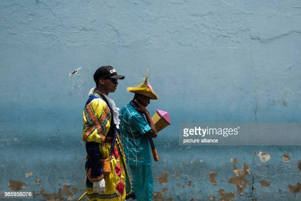 Two members of a Maracatu group wearing costumes during carnival in Nazare de Mata Brazil 13 February 2018 Nazare de mata is a small city in...