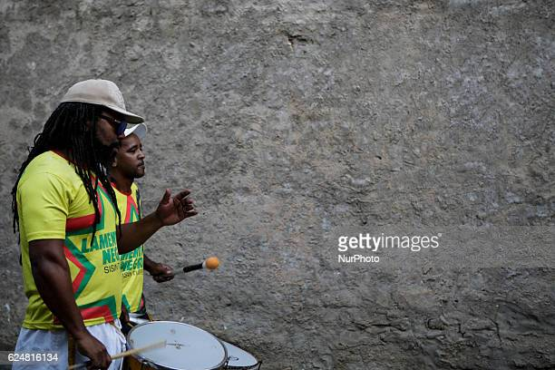 Two members of AfroBrazilian music group Lamento Negro play percussion during presentation Afrodescendent musical groups make a presentation in honor...