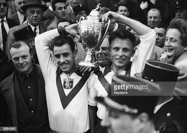 Two members of OSC Lille football team parade with their trophy after beating Bordeaux in the French Cup final.