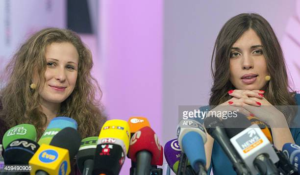 Two members of Russian punk group Pussy Riot Nadezhda Tolokonnikova and Maria Alyokhina answer journalists' questions during their news conference in...