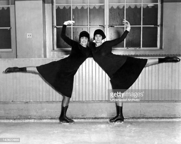 Two members of society practice for an ice skating pageant benefit to be held at Madison Square Garden, New York, New York, December 13, 1927.