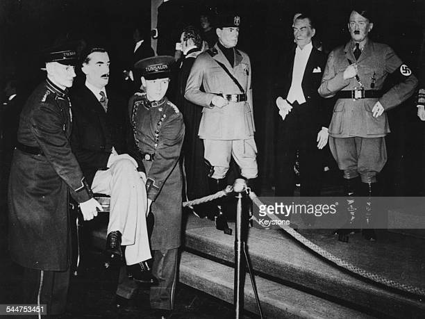Two members of staff carrying a waxwork statue of Prime Minister Sir Anthony Eden at Madame Tussauds with statues of Mussolini Kemal Ataturk and...
