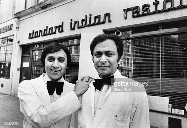 Two members of staff outside the Standard Indian restaurant Westminster London 3rd March 1980