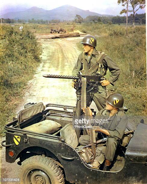 Two members of the 16th Reconnaissance Squadron operating a 30 caliber machine gun mounted on a military jeep during the 1st Cavalry maneuver at the...