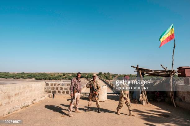 Two members of the Amhara Special Forces with a member of the Amhara militia stand at the border crossing with Eritrea where an Imperial Ethiopian...