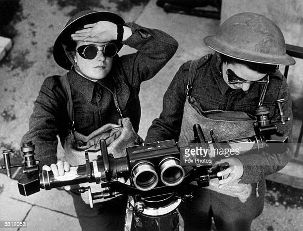 Two members of the ATS, looking out for enemy aircraft. They wear dark glasses to prevent eye-strain.