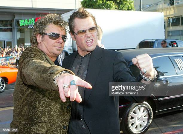 """Two members of the band INXS arrive at the Premiere Of """"The Dukes of Hazzard"""" at the Grauman's Chinese Theatre on July 28, 2005 in Hollywood,..."""