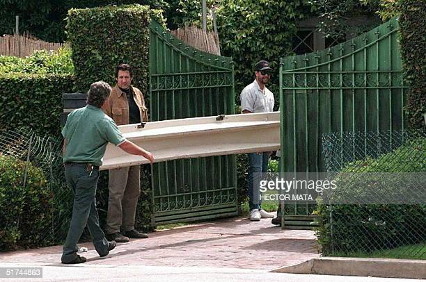 Two members of the Bekins moving company which was hired by the Los Angeles County Sheriff's Department enter the gates of OJ Simpson's house in...