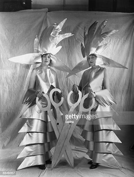 Two members of the cast of the pageant of 'Britain And Her Industries' produced by CB Cochran at the London Pavilion They are posing in metallic...