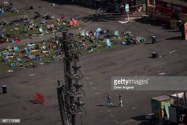 Two members of the FBI work the scene of the mass shooting at the Route 91 Harvest Festival October 3 2017 in Las Vegas Nevada The gunman identified...