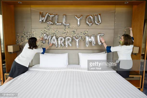 Two members of the guest relations team prepare a room for a wedding proposal at the Shangri-la Hotel at The Shard as it re-opens to the public on...
