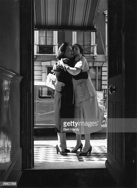Two members of the 'Lyons' family hugging each other goodbye during the film adaptation of the popular radio show 'Life With The Lyons' Original...
