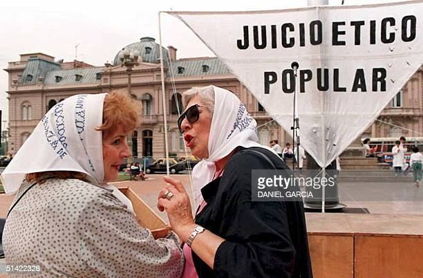 Two members of the Mothers of Plaza de Mayo movement chat in front of the Government Palace 04 May during a rally in Buenos Aires marking the 18th...