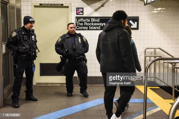 Two members of the New York City Police Department patrol in a subway station on November 14 2019 in New York City The MTA which oversees the New...