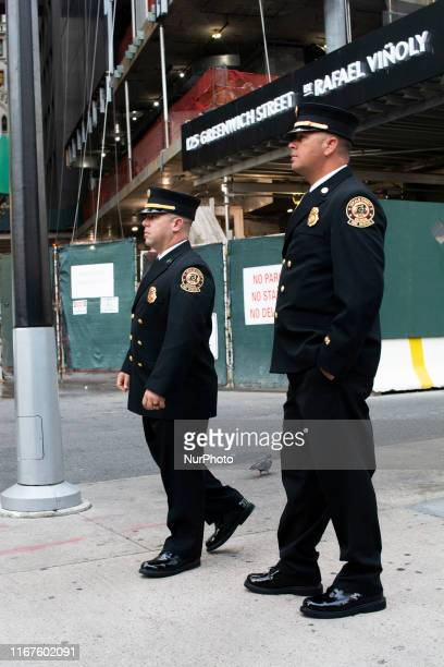 Two members of the New York Fire Department on their way to this year's 9/11 Memorial Ceremony