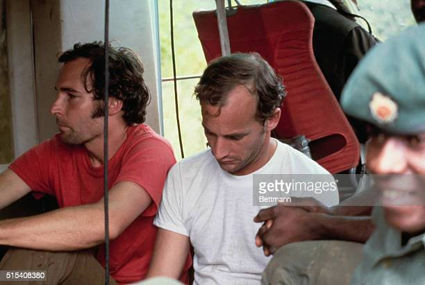 Two members of the People's Temple are held in custody in Georgetown Guyana on November 22 1978 following the Jonestown massacre At left is Michael...