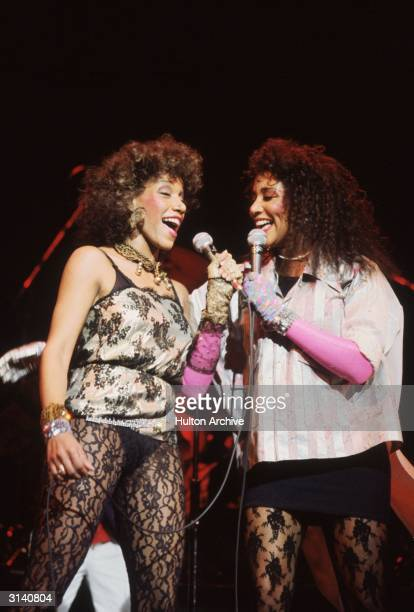 Two members of the soul disco group Sister Sledge on stage at the Hammersmith Odeon in London