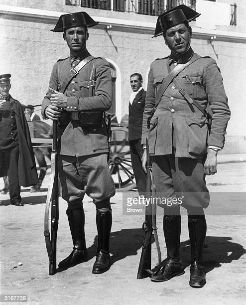 Two members of the Spanish paramilitary 'Guardia Civil' in their uniform with its distinctive headwear